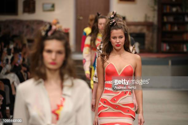 Models walk the runway at the Marina Hoermanseder Defile during 'Der Berliner Salon' Autumn/Winter 2019 at Vollgutlager on January 17 2019 in Berlin...