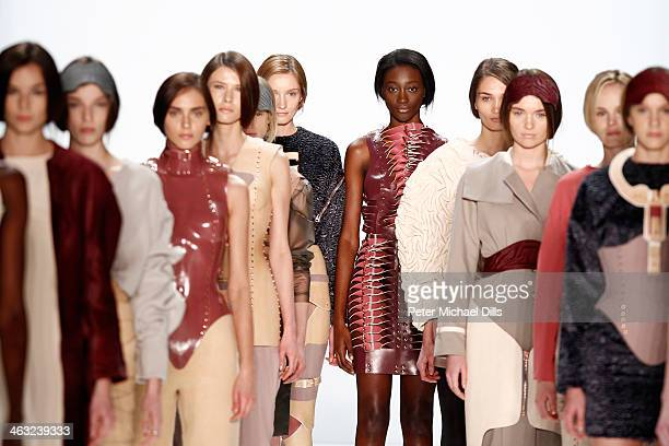 Models walk the runway at the Marina Hoermanseder show during MercedesBenz Fashion Week Autumn/Winter 2014/15 at Brandenburg Gate on January 17 2014...