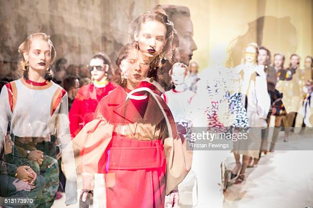 Models walk the runway at the Marni fashion show during Milan Fashion Week Fall/Winter 2016/17 on February 28 2016 in Milan Italy