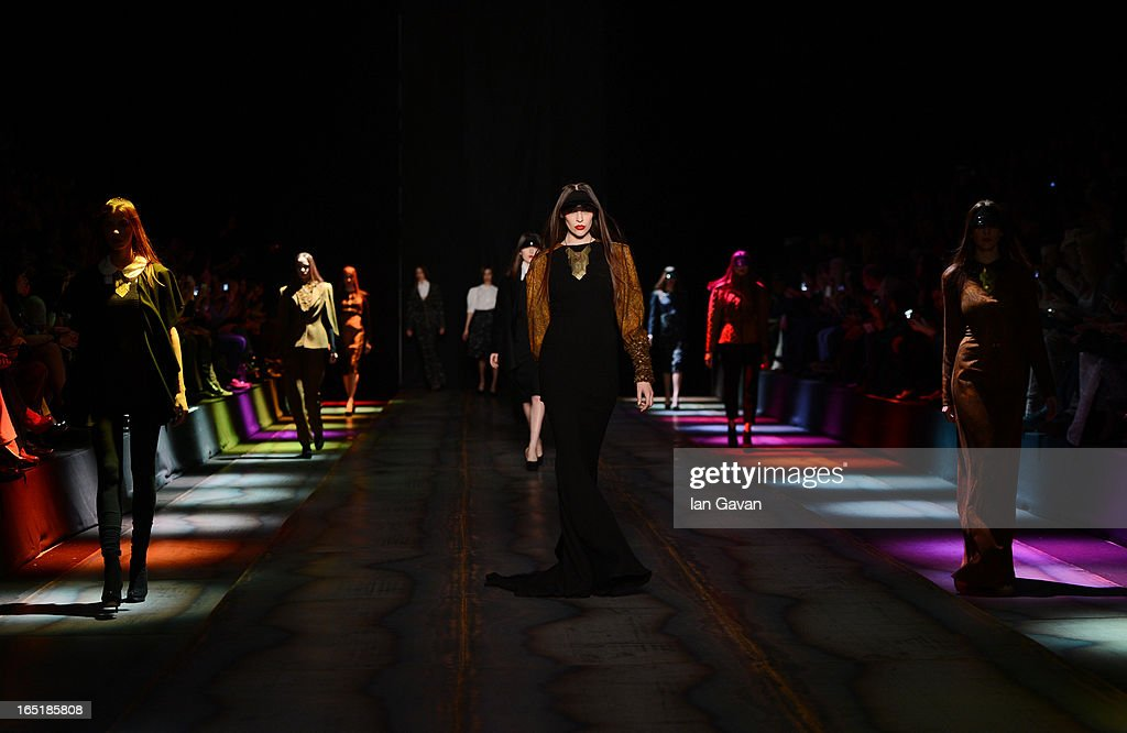 Models walk the runway at the Masha Kravtsova show during Mercedes-Benz Fashion Week Russia Fall/Winter 2013/2014 at Manege on April 1, 2013 in Moscow, Russia.