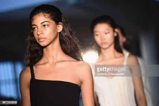 Models walk the runway at the Max Mara Resort Show 2019 at Collezione Maramotti on June 4 2018 in Reggio nell'Emilia Italy