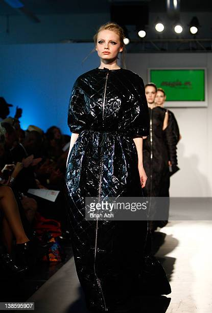 Models walk the runway at the Megla M runway show during Nolcha Fashion Week New York at the Alvin Ailey Studios on February 9 2012 in New York City