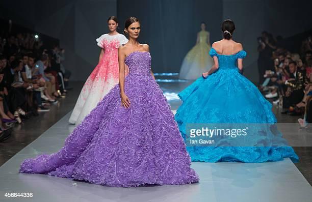 Models walk the runway at the Michael Cinco show during Fashion Forward at Madinat Jumeirah on October 4 2014 in Dubai United Arab Emirates