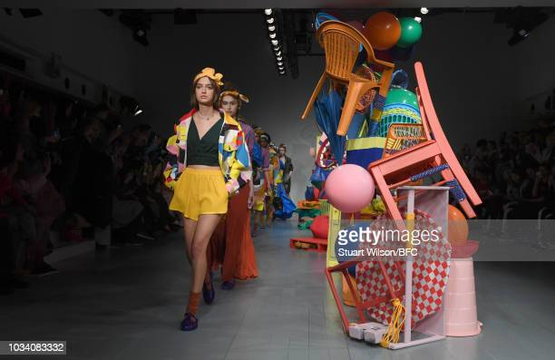 Models walk the runway at the Minki presentation during London Fashion Week September 2018 at The BFC Show Space on September 16, 2018 in London,...