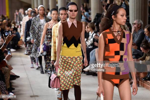 Models walk the runway at the Miu Miu Spring Summer 2018 fashion show during Paris Fashion Week on October 3 2017 in Paris France