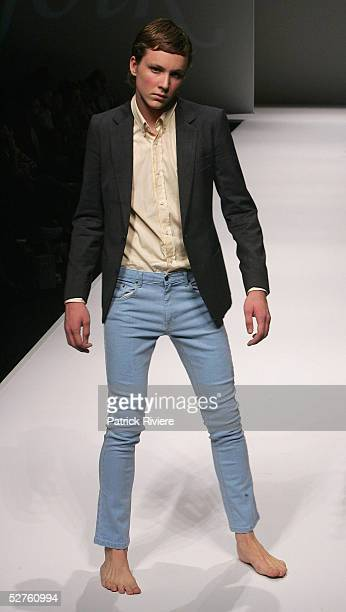 Models walk the runway at the MJOLK Ready To Wear mens collection presentation at the Overseas Passenger Terminal during the Mercedes Australian...