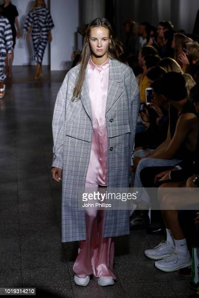 Models walk the runway at the Moire show during Oslo Runway SS19 at Bankplassen 4 on August 15 2018 in Oslo Norway