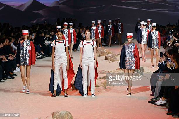 Models walk the runway at the Moncler Gamme Rouge Spring Summer 2017 fashion show during Paris Fashion Week on October 5 2016 in Paris France