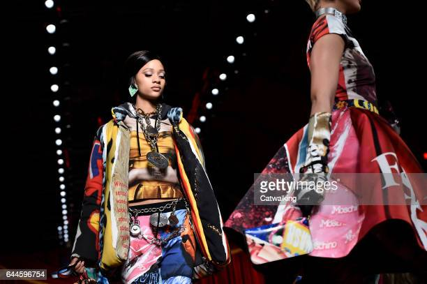 Models walk the runway at the Moschino Autumn Winter 2017 fashion show during Milan Fashion Week on February 23 2017 in Milan Italy