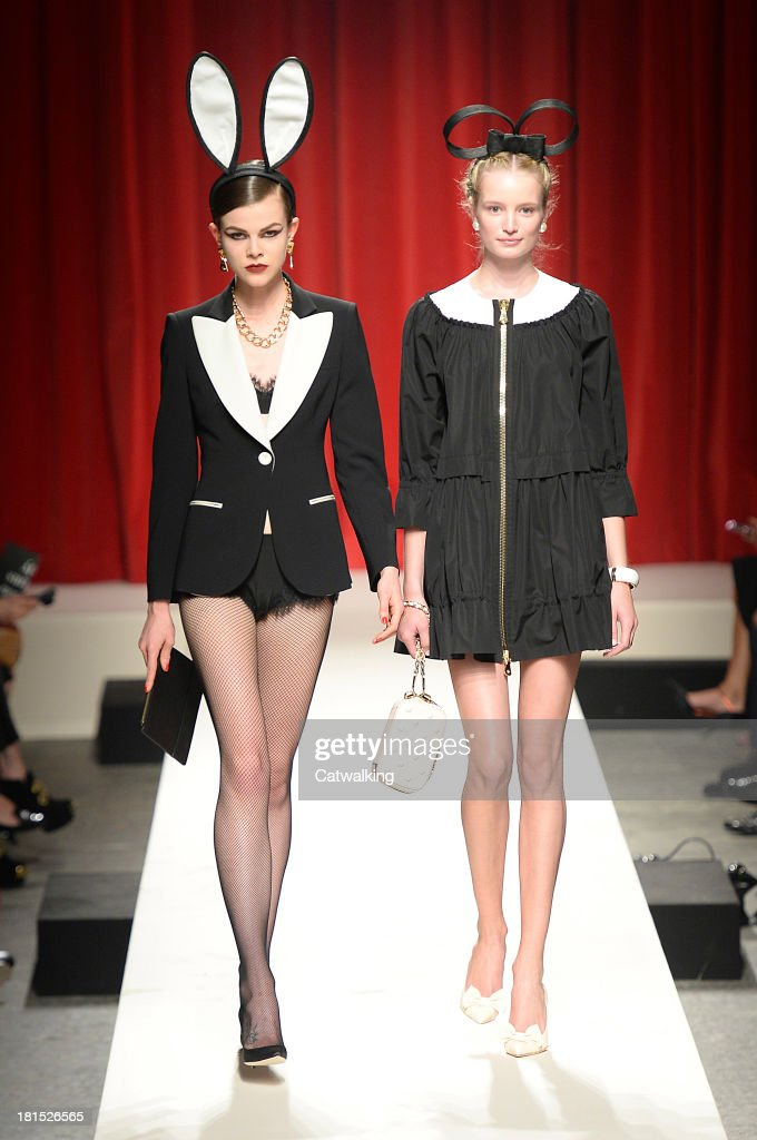 Models walk the runway at the Moschino Spring Spring Summer 2014 fashion show during Milan Fashion Week on September 21, 2013 in Milan, Italy.