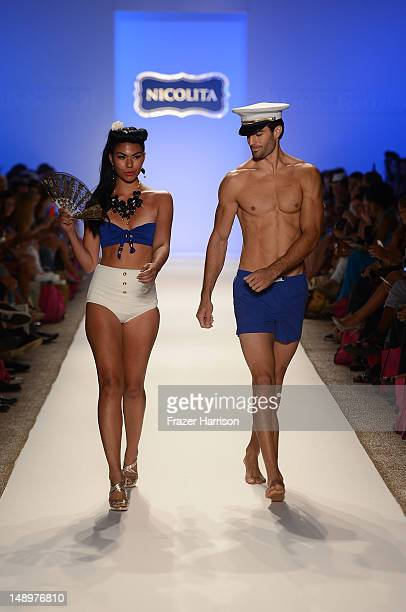 Models walk the runway at the Nicolita show during MercedesBenz Fashion Week Swim 2013 at The Raleigh on July 20 2012 in Miami Beach Florida