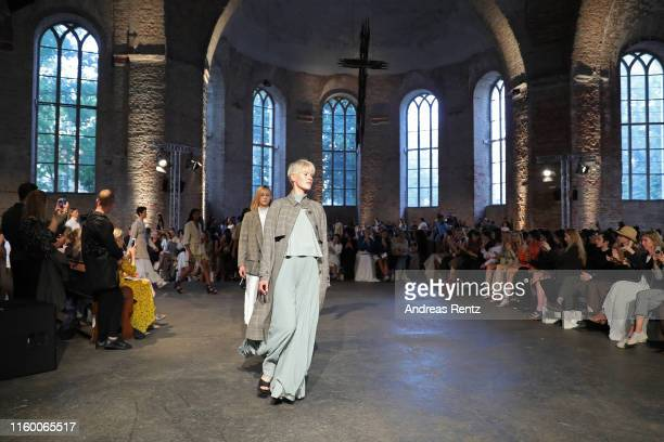 Models walk the runway at the Nobi Talai fashion show during the Berlin Fashion Week Spring/Summer 2020 at Parochialkirche on July 04 2019 in Berlin...