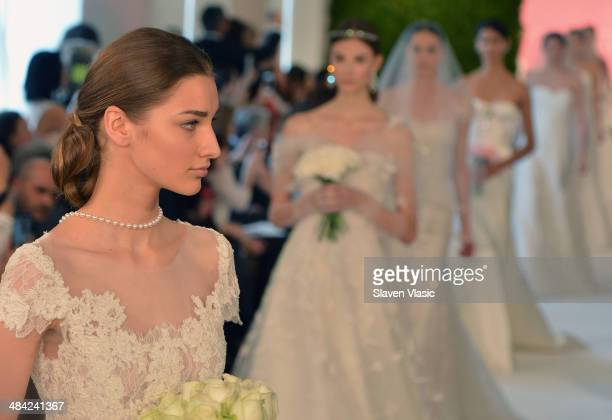 Models walk the runway at the Oscar De La Renta Spring 2015 Bridal collection show on April 11 2014 in New York City