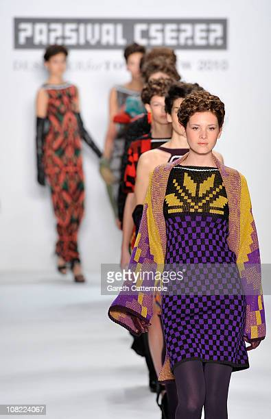 Models walk the runway at the Parsival Cserer Show winner of 'Designer for tomorrow 2010' presented by Peek Cloppenburg during the Mercedes Benz...