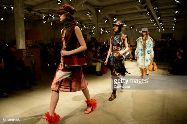 Models walk the runway at the Prada Autumn Winter 2017 fashion show during Milan Fashion Week on February 23 2017 in Milan Italy