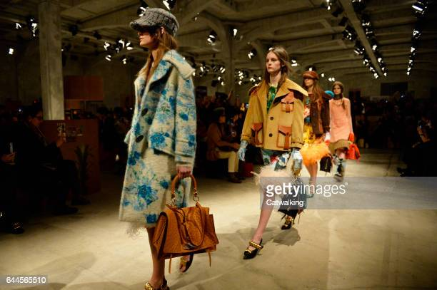 Models walk the runway at the Prada Autumn Winter 2017 fashion show during Milan Fashion Week on February 23 2017 in Milan Italy