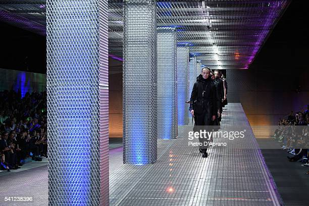 Models walk the runway at the Prada show during Milan Men's Fashion Week Spring/Summer 2017 on June 19 2016 in Milan Italy