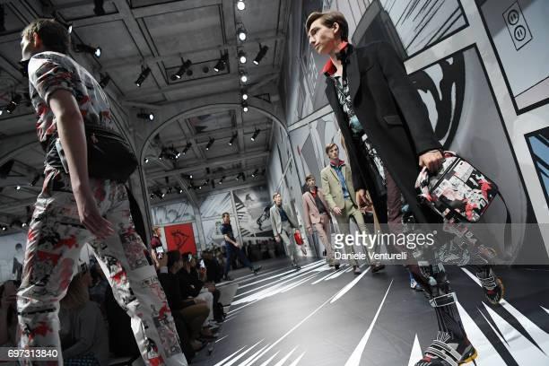 Models walk the runway at the Prada show during Milan Men's Fashion Week Spring/Summer 2018 on June 18 2017 in Milan Italy