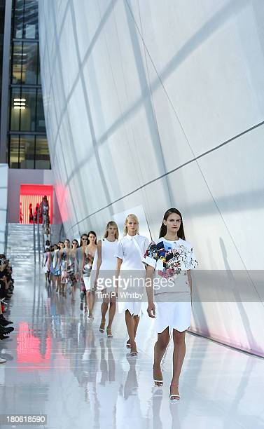 Models walk the runway at the Preen By Thornton Bregazzi show at the Natural History Museum during London Fashion Week SS14 on September 15 2013 in...