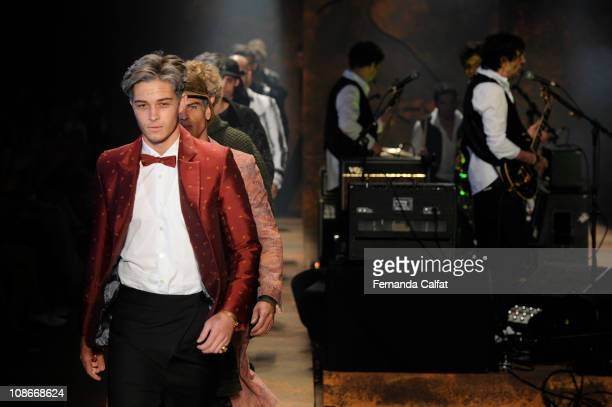 Models walk the runway at the Reserva show during the fourth day of Sao Paulo Fashion Week Fall 2011 at Ibirapuera's Bienal Pavilion on January 31...