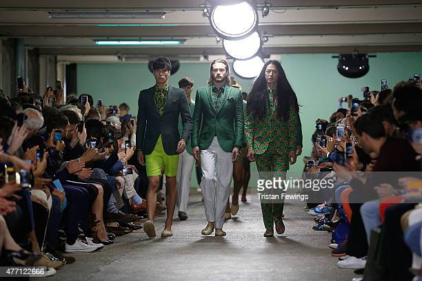 Models walk the runway at the Richard James show during The London Collections Men SS16 at the ICA car park on June 14, 2015 in London, England.