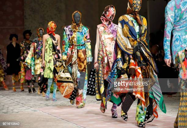 Models walk the runway at the Richard Quinn show during London Fashion Week February 2018 at BFC Show Space on February 20, 2018 in London, England.