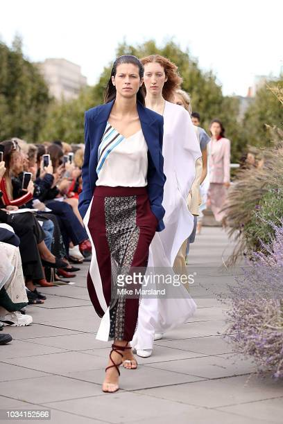 Models walk the runway at the Roland Mouret show during London Fashion Week September 2018 at the NAtional Theatre on September 16, 2018 in London,...