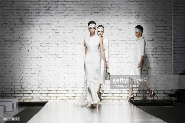 Models walk the runway at the Sabrina Persechino show during Altaroma on January 26 2018 in Rome Italy