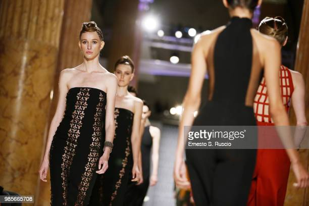 Models walk the runway at the Sabrina Persechino show during Altaroma at Palazzo delle Esposizioni on June 27 2018 in Rome Italy