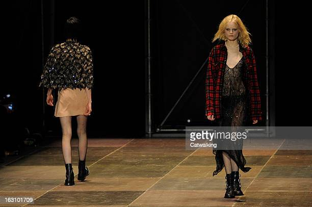 Models walk the runway at the Saint Laurent Autumn Winter 2013 fashion show during Paris Fashion Week on March 4, 2013 in Paris, France.
