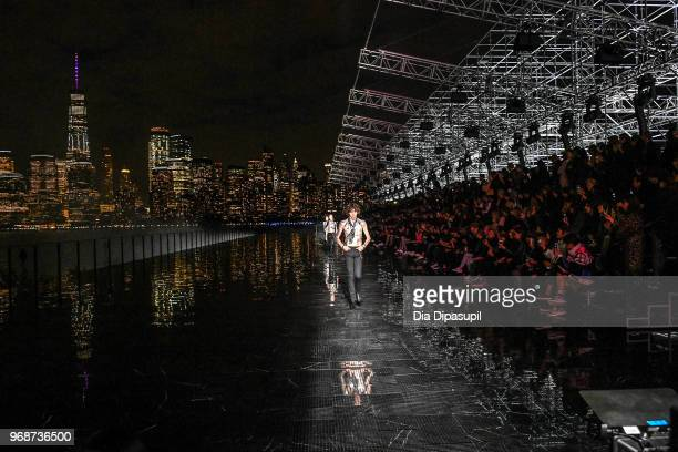 Models walk the runway at the Saint Laurent Resort 2019 Runway Show on June 6 2018 in New York City