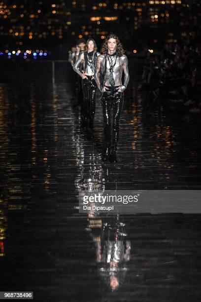 Models walk the runway at the Saint Laurent Resort 2019 Runway Show on June 6 2018 in New York City