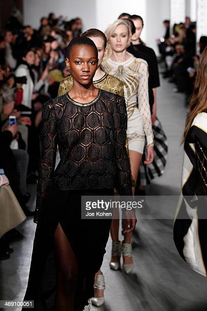 Models walk the runway at the Sass Bide fashion show during MercedesBenz Fashion Week Fall 2014 at The Waterfront on February 12 2014 in New York City