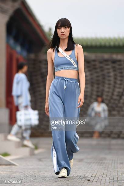 Models walk the runway at the SILUNISHANG & PURE TOUCH collection show on day two of 2021 Beijing Fashion Week at Longfu Cultural Center on September...