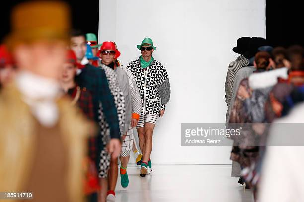 Models walk the runway at the SLAVA ZAITSEV PretAporter De Luxe show during MercedesBenz Fashion Week Russia S/S 2014 on October 26 2013 in Moscow...