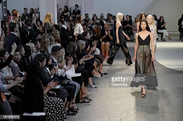 Models walk the runway at the Sportmax Spring Summer 2014 fashion show during Milan Fashion Week on September 20, 2013 in Milan, Italy.