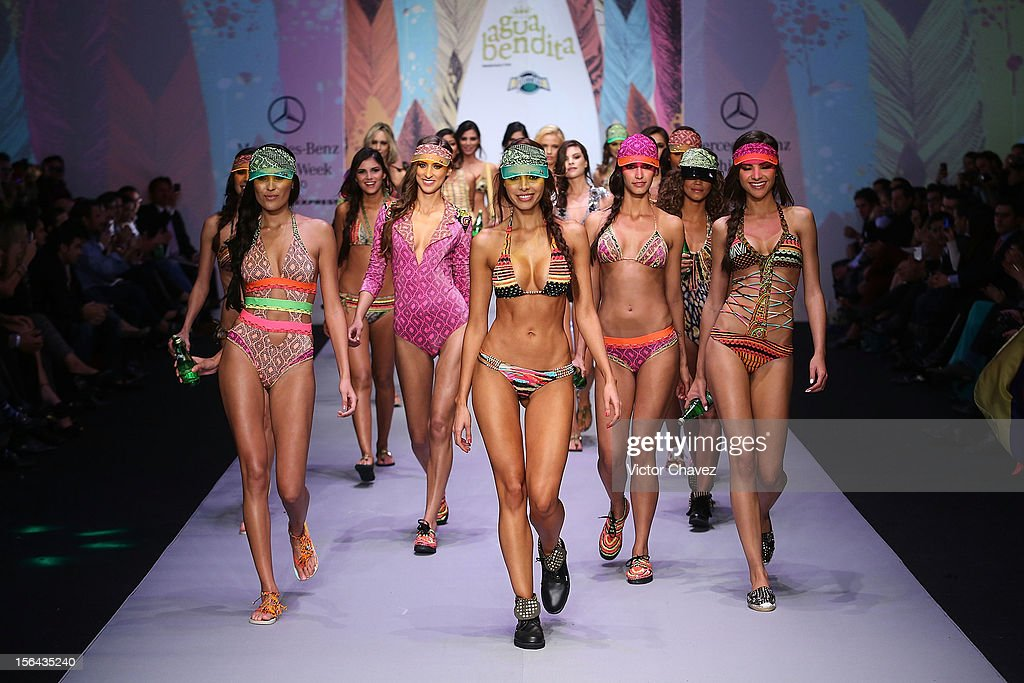 Models walk the runway at the spring/summer 2013 collection of Agua Bendita during the third day of Mereceds-Benz Fashion Week Mexico at Carpa Santa Fe on November 14, 2012 in Mexico City, Mexico.