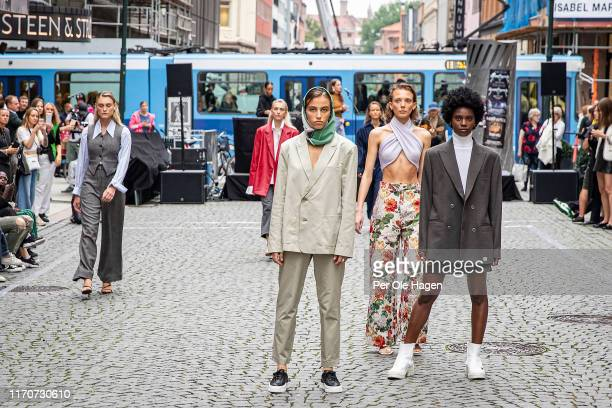 Models walk the runway at the street viewing of Norwegian Design at the opening of the Richie Talboy and Yael Quint Exhibition at the Fushion Fashion...