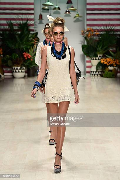 Models walk the runway at the Talulah show during MercedesBenz Fashion Week Australia 2014 at Carriageworks on April 8 2014 in Sydney Australia