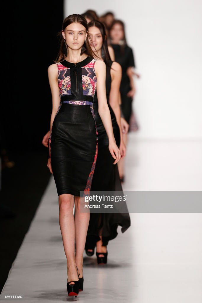 Models walk the runway at the Tel Aviv Fashion Week Collections show during Mercedes-Benz Fashion Week Russia S/S 2014 on October 28, 2013 in Moscow, Russia.