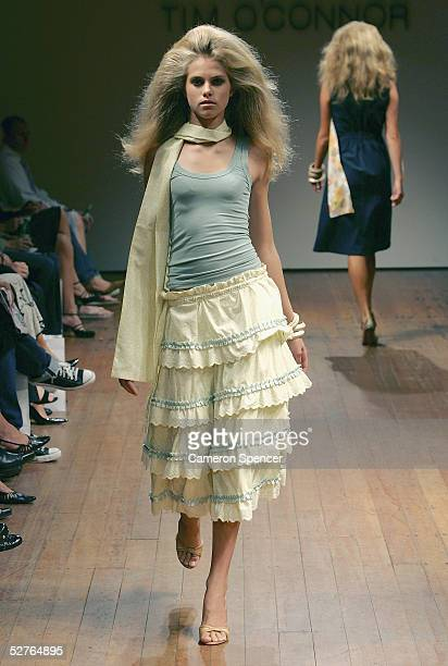 Models walk the runway at the Tim O'Connor collection presentation at the Billich Gallery during the Mercedes Australian Fashion Week May 6, 2005 in...