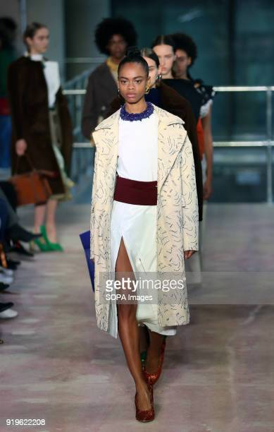 Models walk the runway at the TOGA show during London Fashion Week February 2018 at BFC Show Space