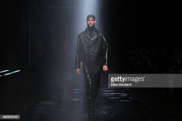 Models walk the runway at the Topman Design show during The London Collections: Men Autumn/Winter 2014 on January 6, 2014 in London, England.