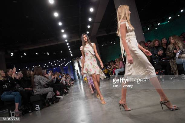 Models walk the runway at the Topshop Unique show during the London Fashion Week February 2017 collections on February 19 2017 in London England