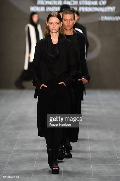 Models walk the runway at the Umasan show during the Mercedes-Benz Fashion Week Spring/Summer 2015 at Erika Hess Eisstadion on July 10, 2014 in...