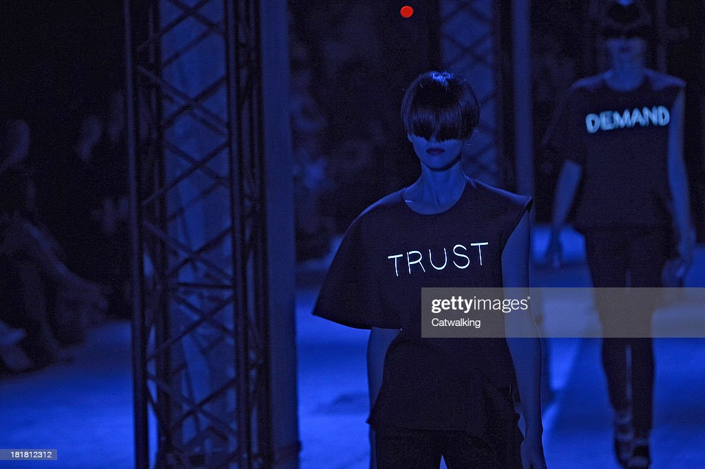 Models walk the runway at the Undercover Spring Summer 2014 fashion show during Paris Fashion Week on September 25, 2013 in Paris, France.