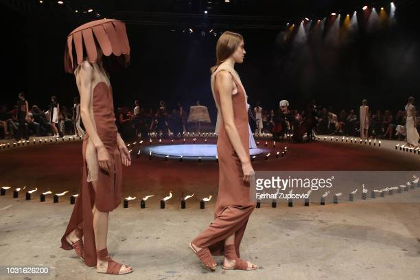 Models walk the runway at the Urun show during the MercedesBenz Istanbul Fashion Week on September 11 2018 in Istanbul Turkey