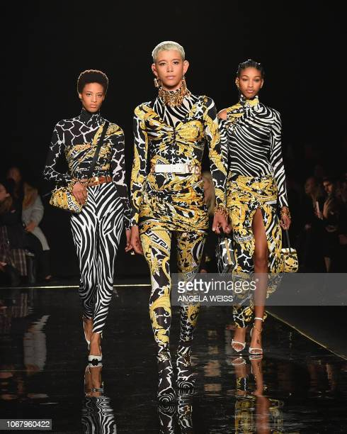 Models walk the runway at the Versace PreFall 2019 Runway Show on December 2 2018 in New York City