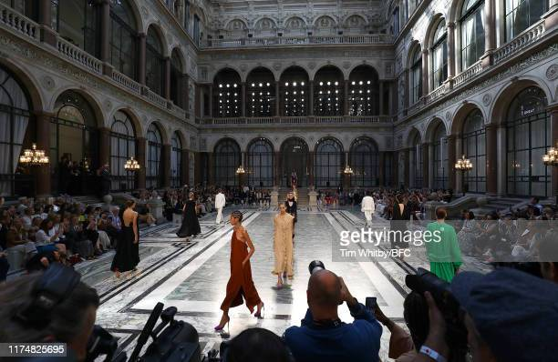 Models walk the runway at the Victoria Beckham show during London Fashion Week September 2019 at the British Foreign and Commonwealth Office on...