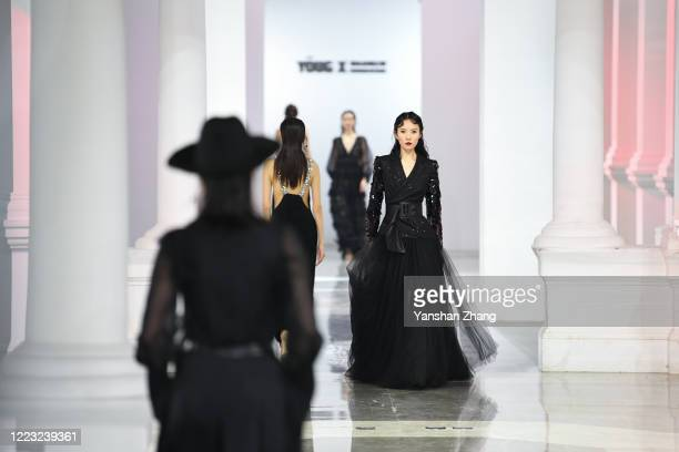 Models walk the runway at the YONG X collection show by Chinese designer Yong Xing during the China Fashion Week 2020/2021 A/W Collection on May 6...
